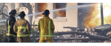 Firefighters extinguish a blaze in a residential area. Personal property damaged in the fire will be covered by e-djuster, users of Versature business phone service.